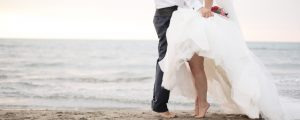 slider bride and groom tippy toe on the beach